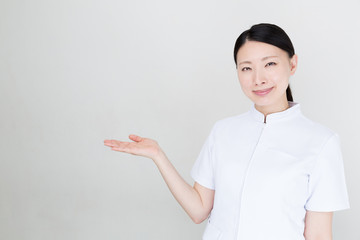 Wall Mural - young asian nurse on white background
