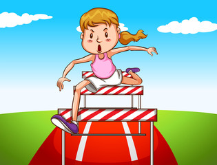 Girl jumping hurdles on track