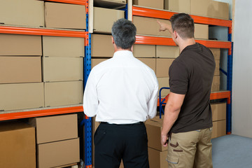 Manager Showing Something To His Worker