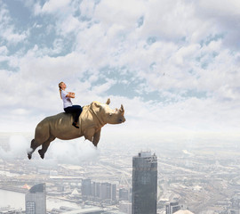 Fototapete - Woman flying rhino