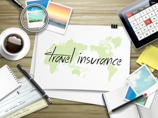 Fototapeta travel insurance written on paper