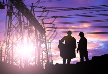 Silhouette engineer looking work over Blurred substation