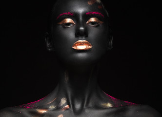 fashion portrait of a dark-skinned girl with color make-up