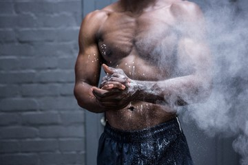 Young Bodybuilder shaking Chalk off his hands