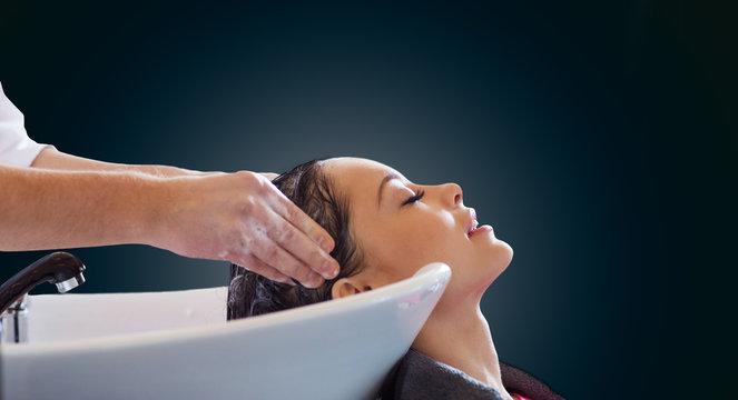 happy young woman at hair salon