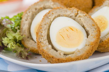 Scotch Egg - Hard-boiled egg wrapped in sausage meat, coated in breadcrumbs and deep-fried.