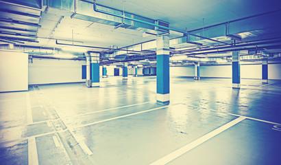 Instagram toned photo of underground parking, industrial backgro