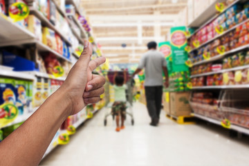 in the supermarket hand mother send signal go to shopping for sa