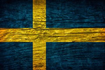 Vintage flag of Sweeden on wooden surface
