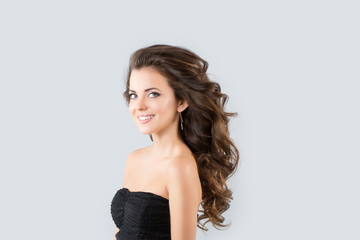 Brunette in a black dress. Glamour Photo
