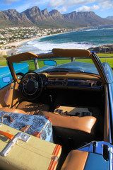 Blue classic car and luggage