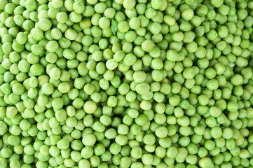 Pile of fresh green peas on display at the Devaraja outdoor market in India