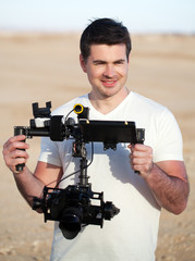 Smiling man with steadicam equipment outdoor