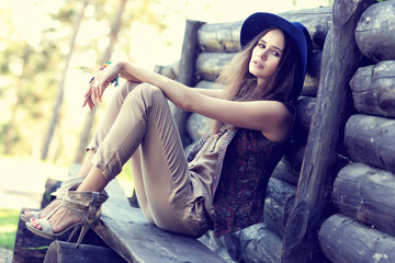 Outdoor fashion portrait of young beautiful woman.