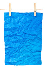 blue paper-a poster on clothespins