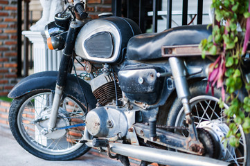 Old motorcycle in vintage place