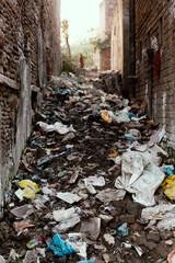 Social Issue, Big garbage heap in between buildings of Indian slums