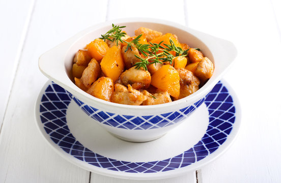 Chicken breast with apricot in a bowl