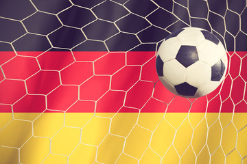 soccer ball on Germany flag vintage color