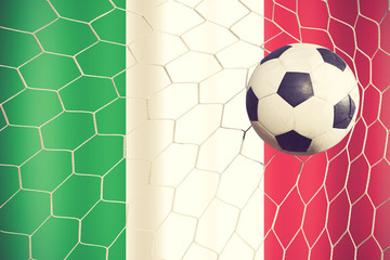 Italy waving flag and soccer ball in goal net vintage color