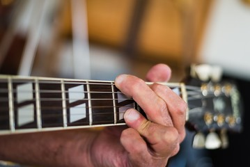 close-up of someone playing the guitar