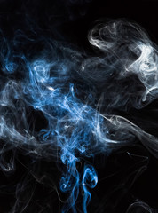 Incense smoke on a black background.