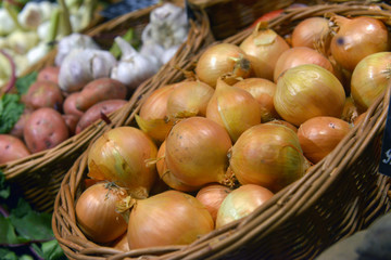 Onions on display in a supermarket