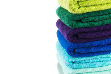 Pile of colorful clean towels isolated on white background