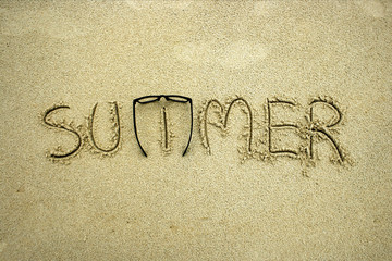 The word summer in the sand
