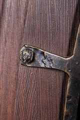 fragment of metal pattern on wooden door with glass