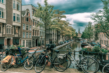 Amsterdam canal and bridge with bikes, Holland
