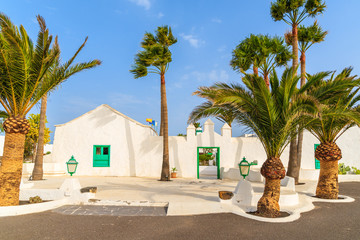 Traditional white houses and palm trees in Yaiza village, Lanzarote island, Spain
