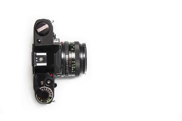 Old 35mm analog camera on white background, isolated