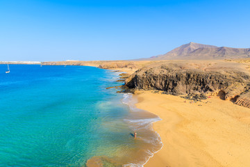 Couple of people in turquoise ocean water on Papagayo beach, Lanzarote, Canary Islands, Spain