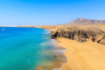 Türaufkleber Kanarische Inseln Couple of people in turquoise ocean water on Papagayo beach, Lanzarote, Canary Islands, Spain