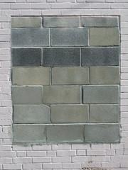 Cinder block wall inside of a brick wall.