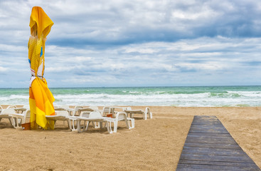 Beach landscape with colored umbrellas, nice sand and blue sky