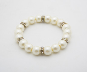 Pearl bracelet of white on a white background