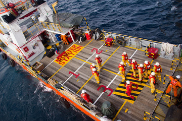 Rig workers are transported on a vessel to offshore rigs in The South China Sea