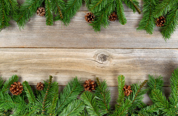 Christmas holiday border with evergreen branches on rustic cedar