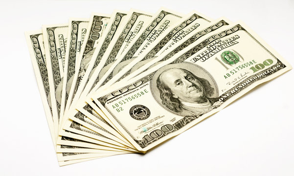 a lot of one hundred dollars isolated on white background