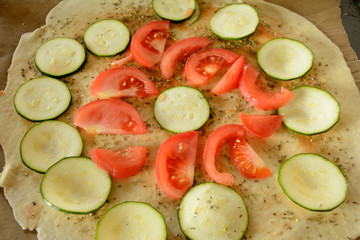 Raw pizza during preparation