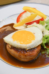 Beef Hamburg steak with egg.
