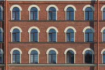 Many equal windows of the factory