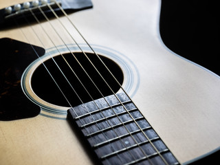 Sound hole and strings of acoustic guitar