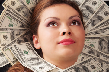 Business woman laying in money.