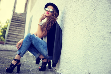 fashion model in sunglasses posing outdoor Wall mural