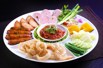 Mix Northern Thai food - Sai Aua (Northern Thai Spicy Sausage), Naem (Sour pork), Cab-Moo (pork snack), Moo-Yor (preserved pork sausage), Nam Prik Aong (Northern Thai Meat and Tomato Spicy Dip)