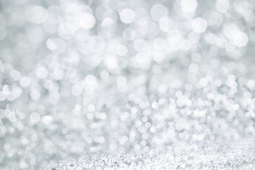 Abstract bokeh lighting background , silver color tone