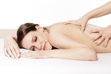 young woman enjoying the pleasant back massage